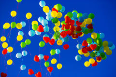 Group of multicolored helium filled balloons in the sky Royalty Free Stock Photography