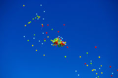 Group of multicolored helium filled balloons in the sky Royalty Free Stock Photos