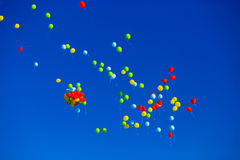 Group of multicolored helium filled balloons in the sky Stock Image