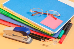 Group of multicolored office folders, glasses and office supplies Stock Images