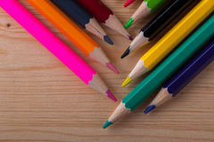 Group of multicolored pencils on wooden table. Stock Photos