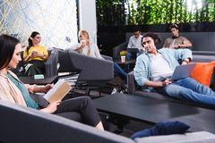 group of multicultural business people working and talking at modern coworking royalty free stock photography