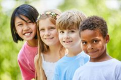 Group of multicultural kids as friends stock photo