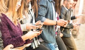Group of multicultural friends using smartphone at university co stock photography
