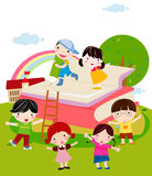 A group of multicultural kids playing with a giant book Royalty Free Stock Photo