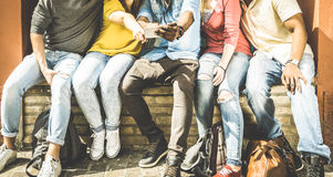 Group of multiculture friends using mobile smart phones. Group of multiculture friends using smartphone on urban background - Technology addiction concept in Royalty Free Stock Photo