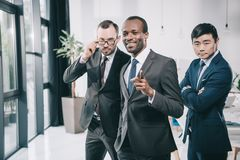 Group of multiethic businessmen looking. At camera royalty free stock images