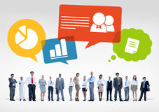 Group of Multiethnic Business People with Business Symbols Stock Photography