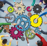 Group of Multiethnic Business People with Cog Symbols Royalty Free Stock Photo