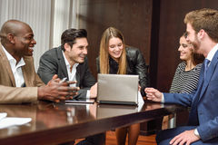 Group of multiethnic busy people working in an office. Businesspeople, teamwork. Group of multiethnic busy people working in an office Royalty Free Stock Images