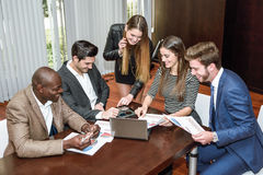 Group of multiethnic busy people working in an office Royalty Free Stock Image