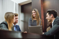 Group of multiethnic busy people working in an office Stock Images