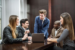 Group of multiethnic busy people working in an office Stock Photos