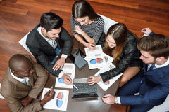 Group of multiethnic busy people working in an office. Businesspeople, teamwork. Group of multiethnic busy people working in an office. Top view Stock Photo