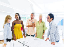 Group of Multiethnic Designers Having a Meeting Royalty Free Stock Photography