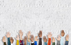 Group of Multiethnic Diverse Hands Raised Stock Photos