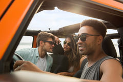 Group of multiethnic friends sitting in a car. And having fun royalty free stock photos