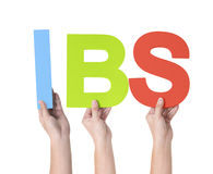 Group of Multiethnic Hands Holding IBS Royalty Free Stock Photos