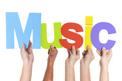 Group of Multiethnic Hands Holding Music Royalty Free Stock Image