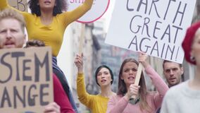 People with banners protest for climate change