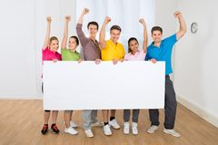 Group of multiethnic people holding blank placard Stock Image