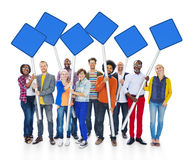 Group Of Multiethnic People Holding Blue Blank Sign Stock Image