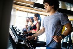 Group of multiethnic sports people make sport exercise in gym. Group of multiethnic sports strong people make sport exercise in gym stock photo