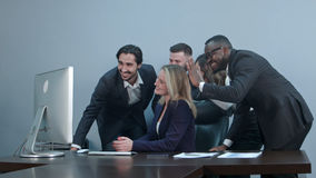 Group of multiracial businesspeople together videoconferencing at workplace Stock Image