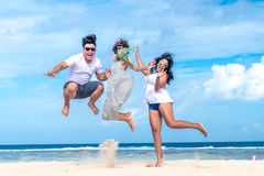 Group of multiracial friends having fun on the beach of tropical Bali island, Indonesia. stock image
