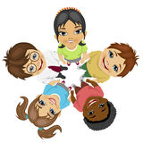 Group of multiracial kids in a circle looking up holding their hands together Stock Photography