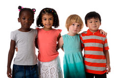 Group of multiracial kids portrait in studio.Isolated. Group of multiracial kids portrait in studio on white background royalty free stock photo