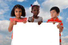 Group of multiracial kids portrait with white board. Royalty Free Stock Photo