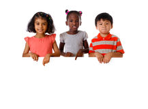 Group of multiracial kids portrait with white board.Isolated Royalty Free Stock Photography