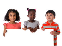Group of multiracial kids portrait with white board.Isolated Royalty Free Stock Photo
