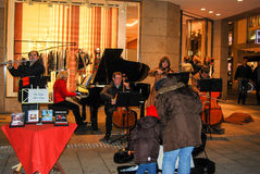 A group of musicians play at night in downtown Munich Royalty Free Stock Photos