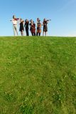 Group of musicians play violins on hill Stock Photos