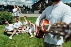 Group of musicians playing musical instruments. A group of musicians playing musical instruments on the street. In the foreground is a musician with a guitar royalty free stock photo