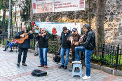 Group of musicians playing on the street in Istanbul. Turkey. Istanbul, Turkey - November 01, 2016: Group of musicians playing on the street near Galata tower stock images