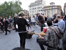 Musicians on a street of Rome. A group of musicians during a street concert royalty free stock image