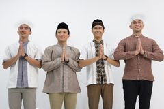 Muslim Men`s Group Photoshoot. Group of muslim men  who greeting and smiling in front of the camera Royalty Free Stock Images