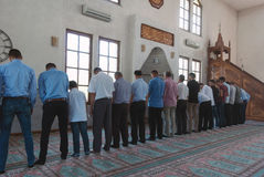 Group of muslims standing at prayer in mosque Stock Photography