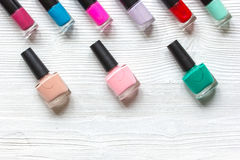 Group of nail polish on wooden background top view Royalty Free Stock Photos