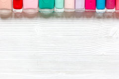 Group of nail polish on wooden background top view Stock Images