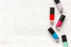 Group of nail polish on wooden background top view Stock Photo