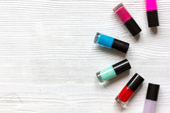 Group of nail polish on wooden background top view Stock Photos