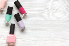 Group of nail polish on wooden background top view Stock Photography