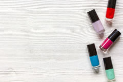 Group of nail polish on wooden background top view Royalty Free Stock Photo