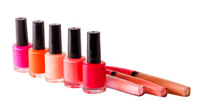 Group of nail polishes and lip glosses isolated on white. Selective focus Stock Images
