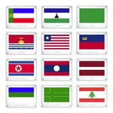 A Group of National Flags on Metal Texture Plates Stock Photo