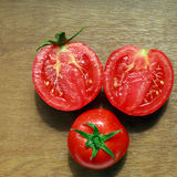 Group of natural juicy tomato with drops of dew Royalty Free Stock Images